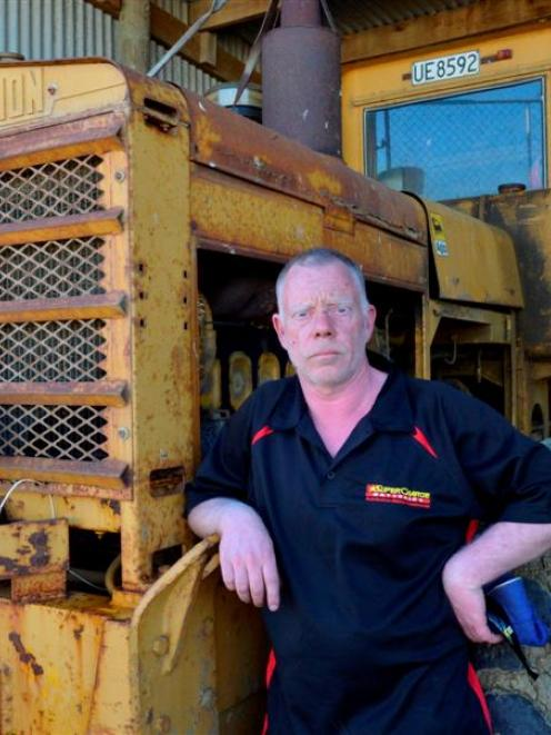 Beachlands track maintenance manager Tony Duncan with a grader, one of three vehicles that had ...