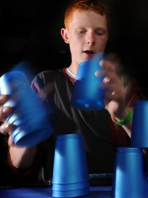 Ben Lovelock shows his sport stacking talent. Photo by Craig Baxter.