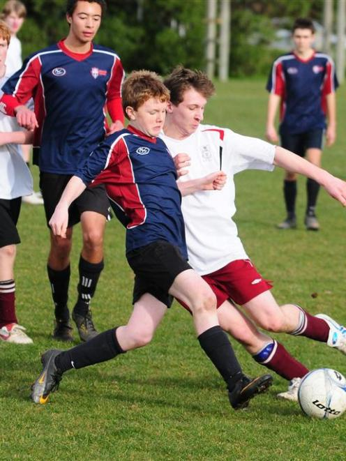 Ben O'Farrell (Kavanagh, left)  and Tim O'Neill (Logan Park High) battle it out for possession....
