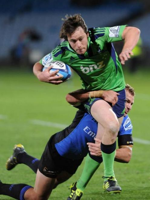 Ben Smith crosses for the Highlanders early in last night's match against the Force. The...