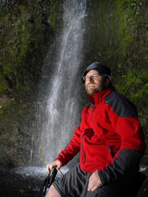 Beside the 15m-high Nicols Falls, Dunedin lawyer and tramper Antony Hamel considers the city's ...