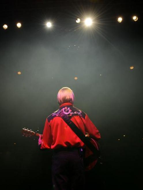 Bevan Gardiner performs as John Denver during rehearsals for Whisper the Wind in Dunedin. Photo...