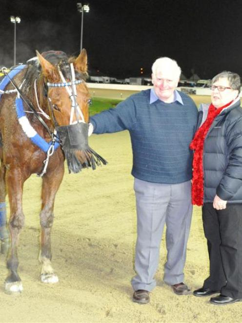 Beyond Reason with owners Bill and Shirley Stevenson after success at Forbury Park on Thursday...