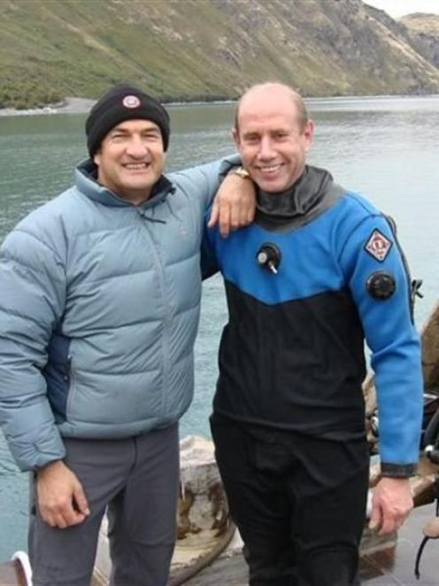 Bill Day (left) and Dr Simon Mitchell during the dive for Haast pilot Morgan Saxton's helicopter...