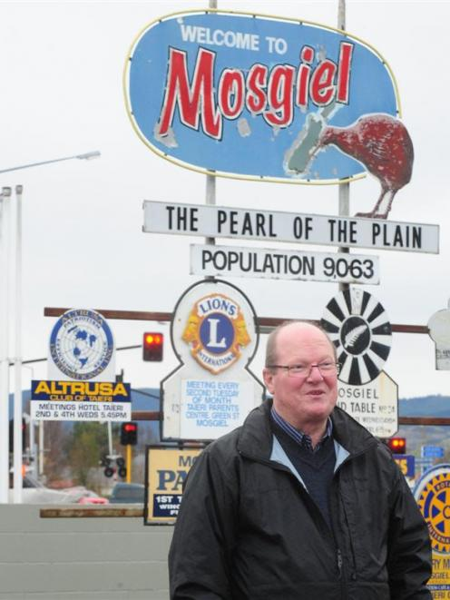 Bill Feather with the sign in 2011. Photo by the ODT.