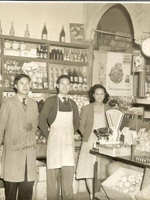 Bill (left), George and their sister Mary in Wong Bros fruit shop in the 1950s. Photo supplied.