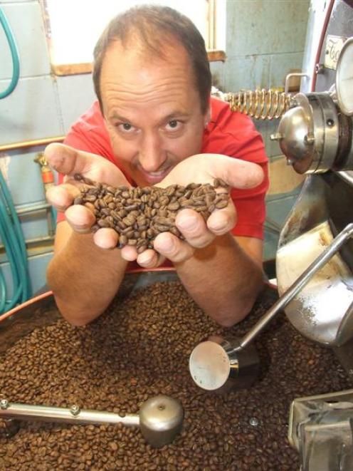 Bill Yuill, of Bean Around the World,  with some of his award-winning coffee beans.  For the...
