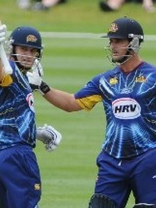 Black Caps and Otago all-rounder Nathan McCullum (left) is congratulated for reaching 50 by team...