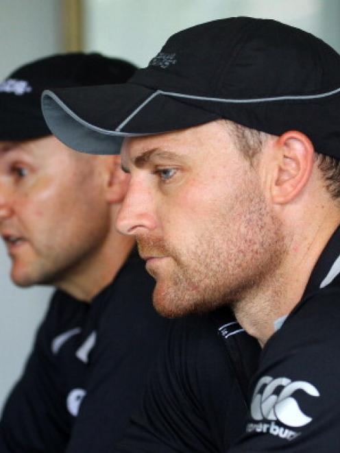 Black Caps captain Brendon McCullum (R) and coach Mike Hesson attend a press conference in Durban...