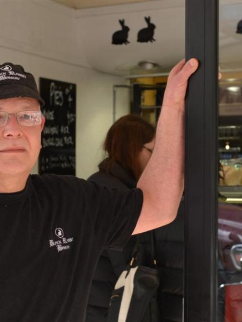 Black Rabbit Bakery owner Shane Ross stands outside his artisan bakery, in George St, before he...