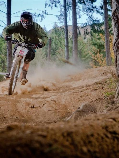 Blair Smith, of Wanaka, tears down the tracks of the Queenstown Bike Park during the Corona...