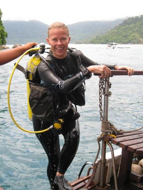 Blue Ventures Malaysia project co-ordinator Katie Yewdall emerges from completing a survey of...