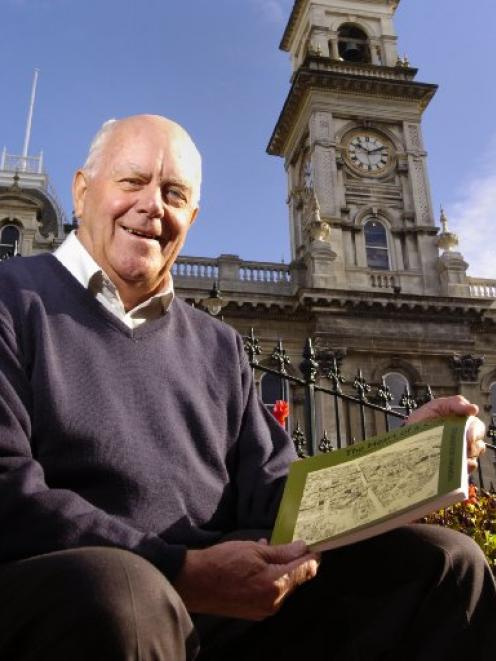 Norman Ledgerwood with his book Heart of a City: the Story of Dunedin's Octagon.  Photo by Peter...
