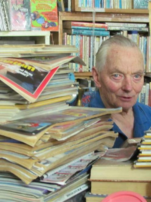 Bookshop owner Derek Workman is dwarfed by his huge book collection in Kurow. Photo by Andrew...