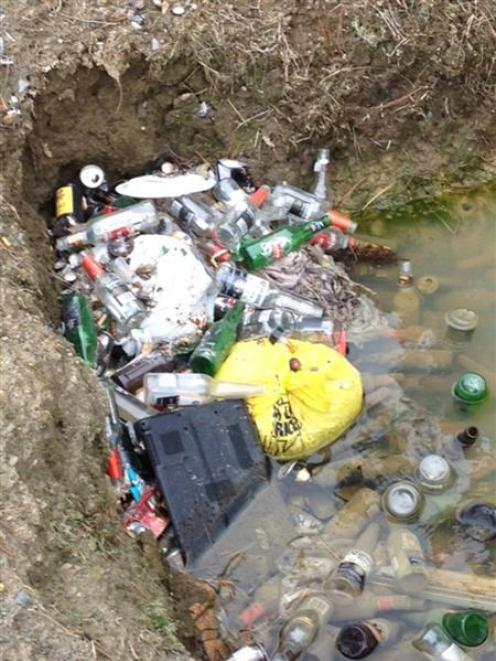 Bottles and general rubbish lie on the side of Flagstaff-Whare Flat Rd, Dunedin, on Saturday....
