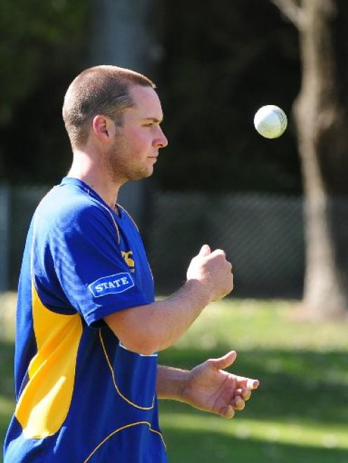 Bowling all-rounder Mark Craig gives the ball a rip during a training session with Otago at the...