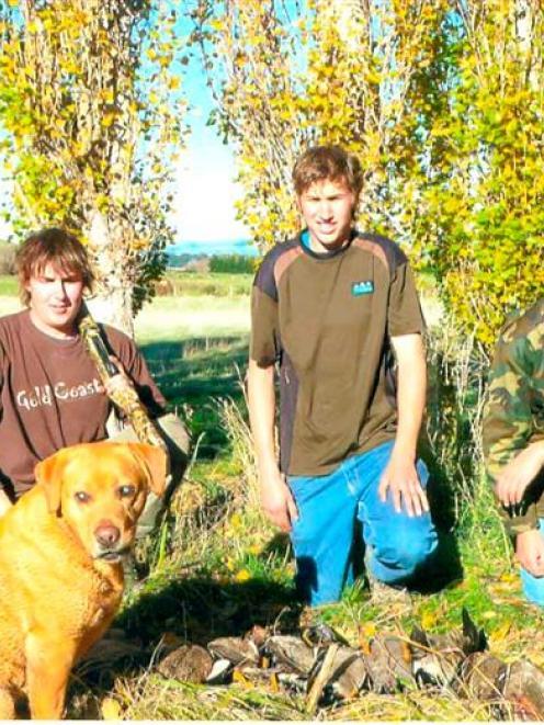 Brad (22, left), John (17) and Micheal (15) Hastie were proud of their blind gun dog Jake's...