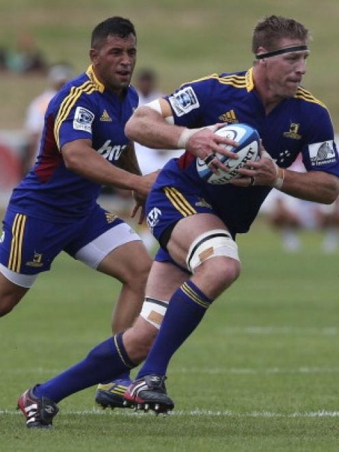 Brad Thorn of Highlanders makes a break during the 2013 Super Rugby pre-season friendly match...