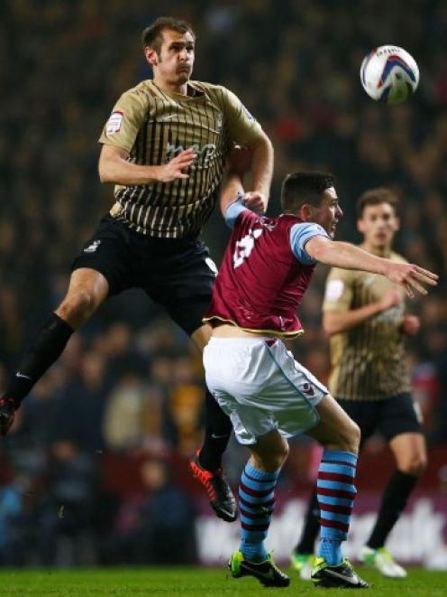 Bradford City's James Hanson (L) jumps above Aston Villa's Ciaran Clark during their English...