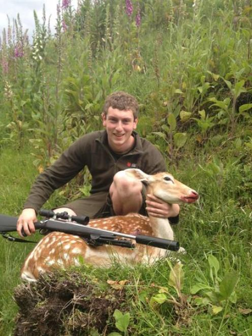 Bradley Robertson (19) with his fallow deer, shot on private property at Waitahuna, South Otago....