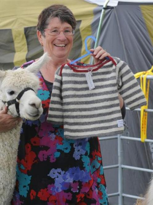 Brenda McLean with a child's jersey made from alpaca fibre at the Southern Field Days at Waimumu...