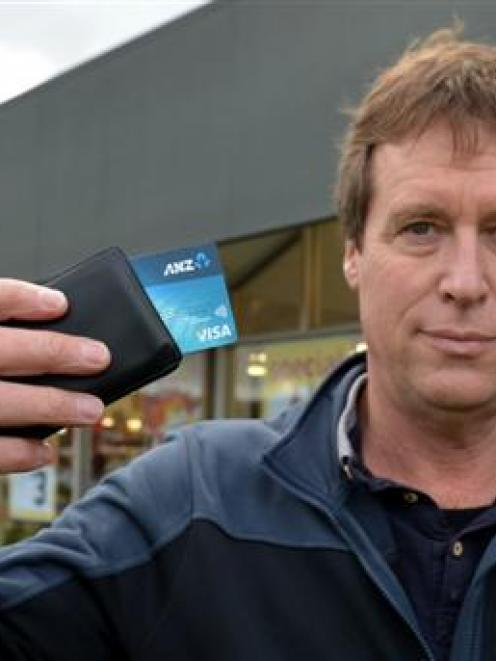 Brian McKay, of Dunedin, holds the Visa payWave credit card with which he  unintentionally paid...