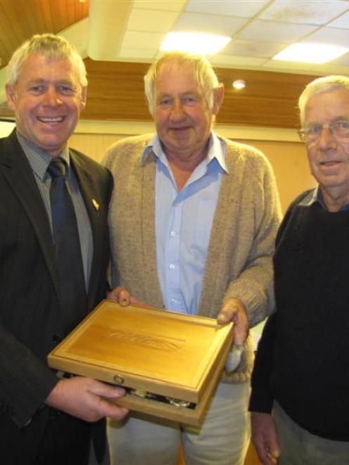 Brian Phillips (right) and Neil McArthur (centre) presented Mr Lepper with a specially made...