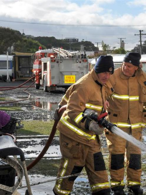 Brighton Volunteer Fire Brigade senior firefighter Barry Day (left) and Chief Fire Officer Ian...