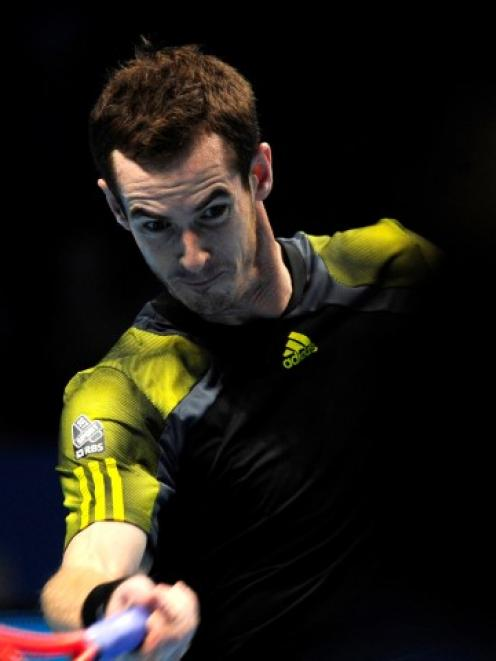 Britain's Andy Murray plays a return to Tomas Berdych of Czech Republic during their singles...