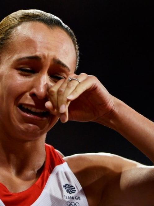 Britain's Jessica Ennis reacts after she won her women's heptathlon 800m heat at the Olympic...
