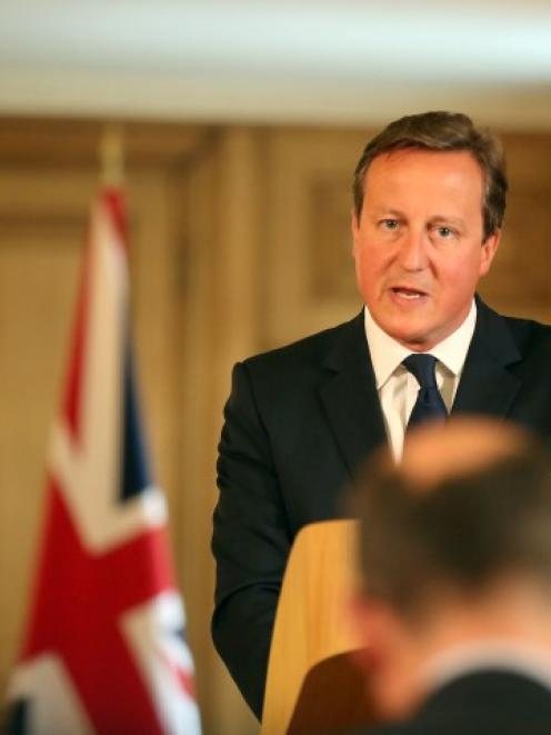 Britain's Prime Minister David Cameron speaks at a news conference in Downing St, central London....