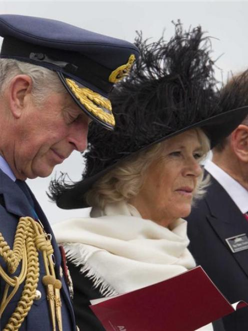 Britain's Prince Charles (L) and his wife Camilla, Duchess of Cornwall, attend an event to...