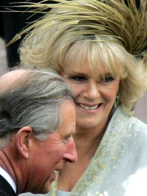 Britain's Prince Charles (L) and the Duchess of Cornwall greet well-wishers at Windsor Castle...