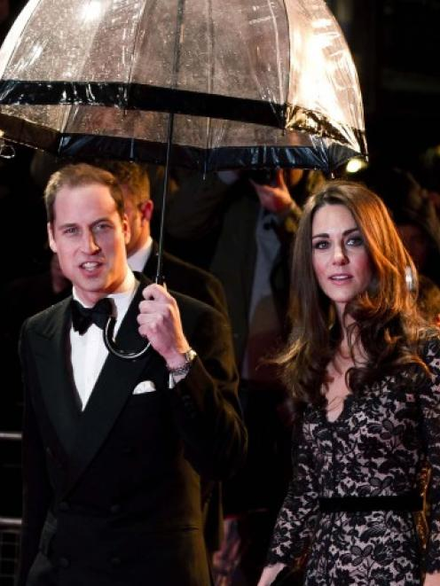 Britain's Prince William (L) and Catherine, Duchess of Cambridge attend the UK premiere of 'War...