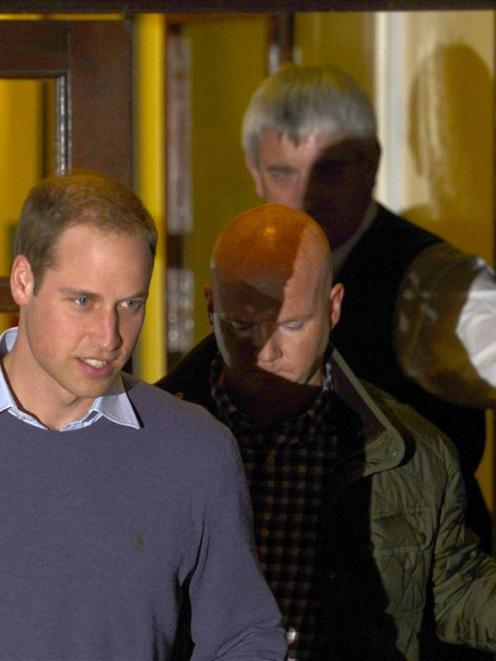 Britain's Prince William leaves after visting his wife Catherine, Duchess of Cambridge, in...