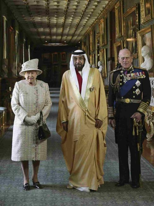 Britain's Queen Elizabeth and Prince Philip, greet the President of the United Arab Emirates,...