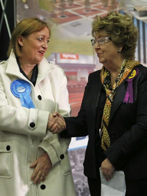 Britain's ruling Conservative Party candidate Christine Emmett (left) congratulates UKIP...