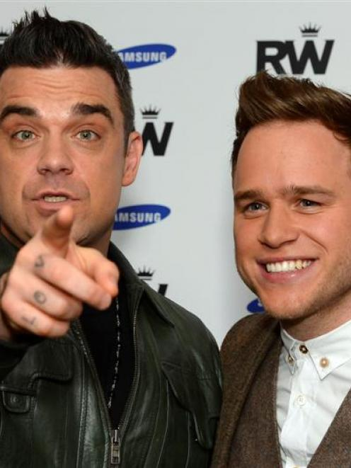 British musicians Robbie Williams and Olly Murs who will support Williams on his 2013 European...
