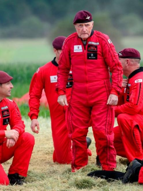 British World War 2 veteran Jock Hutton (89) stands following his landing after he and teams of...