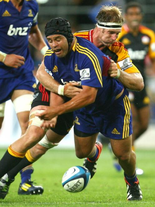 Bronson Murray of the Highlanders is caught in a tackle during match against the Chiefs at...