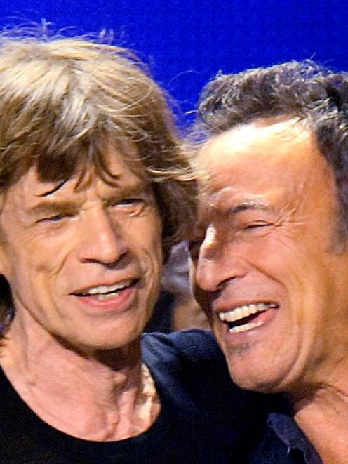 Bruce Springsteen (R) joins Mick Jagger onstage during the Rolling Stones' final concert of their...