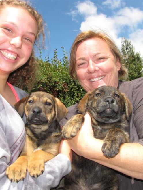 Buffy Paterson (right) at her Wanaka animal shelter with volunteer Callie Turner (13) and ...
