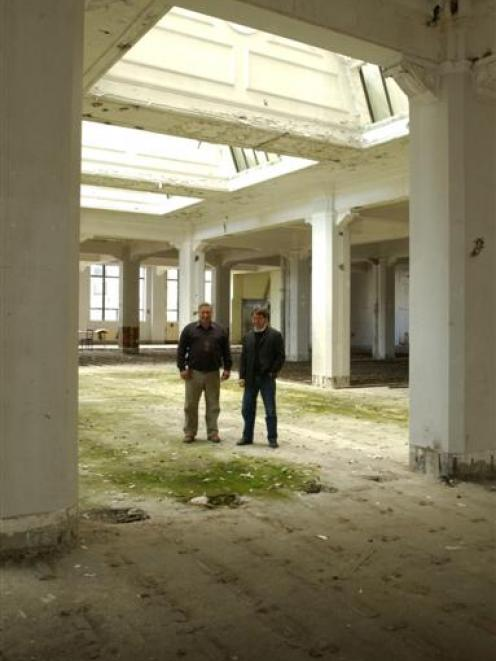 Building owner Geoffrey Thomson (left) and Opus architect Jeff Thompson on the ground floor below...