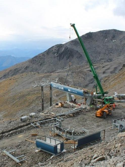 Building the Curvey Basin chairlift is  progressing at the Remarkables ski area.  The...