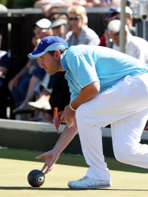 Cabramatta's Matthew Gallop in action at the men's national fours final at the National Bowls...