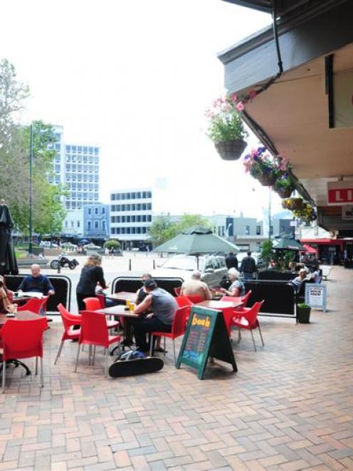 Cafe-goers enjoy alfresco dining in Dunedin's lower Octagon yesterday. Photo by Craig Baxter.