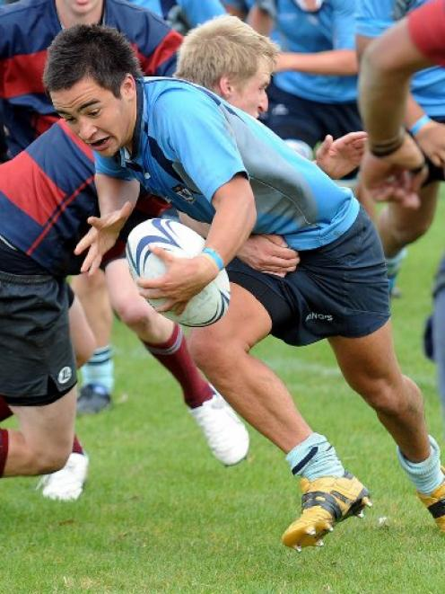 Caleb Gray of Kings goes over to score a try against Kavanagh College at Kings High School on...