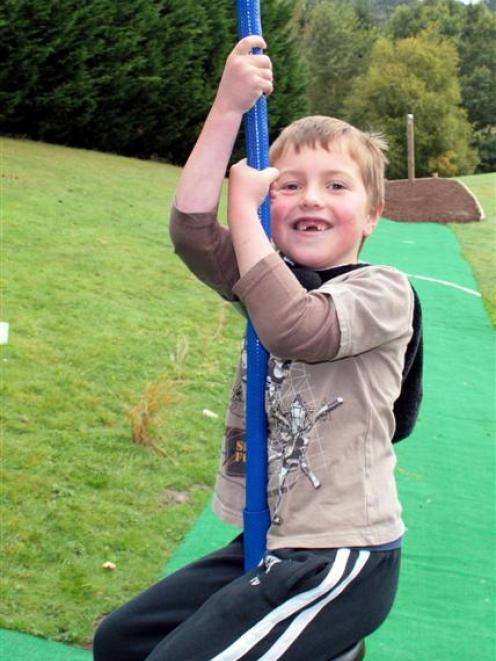 Caleb Mockford (9) is one of the first to try out the new 60m-long flying fox at Bradford School...