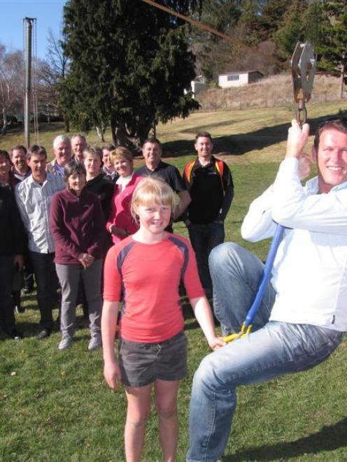 Cambridge Principals' Association chairman Mike Pettit gets a helping hand in the Tarras School...