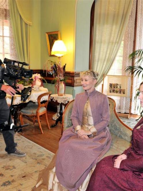 Cameraman Patrick O'Neill films Lyndall Frost (left) and Robyn Swindells in the Larnach Castle...